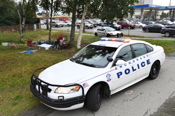 Anchorage Police responded to the scene of homeless camp near Northern Lights Boulevard and Seward Highway and performed life saving measures on an unresponsive woman who was later declared deceased on Wednesday, Sept. 16, 2020. (Bill Roth / ADN)