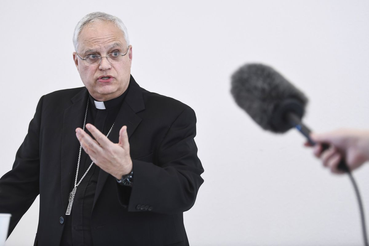 In this photo taken Wednesday, Aug. 21, 2019, Father Andrew E. Bellisario, the bishop of the Diocese of Juneau, holds a press conference to talk about an independent review he commissioned on allegations of sexual misconduct by clergymen in the Diocese of Juneau. (Michael Penn /The Juneau Empire via AP)