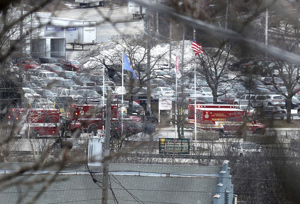 Milwaukee Police and Milwaukee Fire Dept. personnel respond to reports of an active shooting at the Molson Coors Brewing Co. campus in Milwaukee, Wednesday, Feb. 26, 2020. (Rick Wood/Milwaukee Journal-Sentinel via AP)