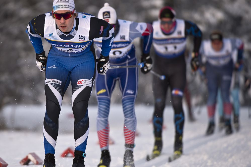 Reese Hanneman leads skiers toward the finish line in the quarterfinals. The final day of the U.S. Cross Country Ski Championships featured men's and women's classic sprint racing on January 8, 2018. (Marc Lester / ADN)