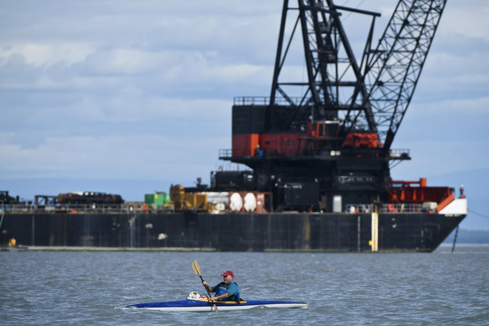 Chuck Freedman kayaks near the mouth of Ship Creek with Paris, his Parson Russell Terrier, on July 24, 2020. Freedman said he kayaks a few times a week and that Paris rides along nearly every time. (Marc Lester / ADN)