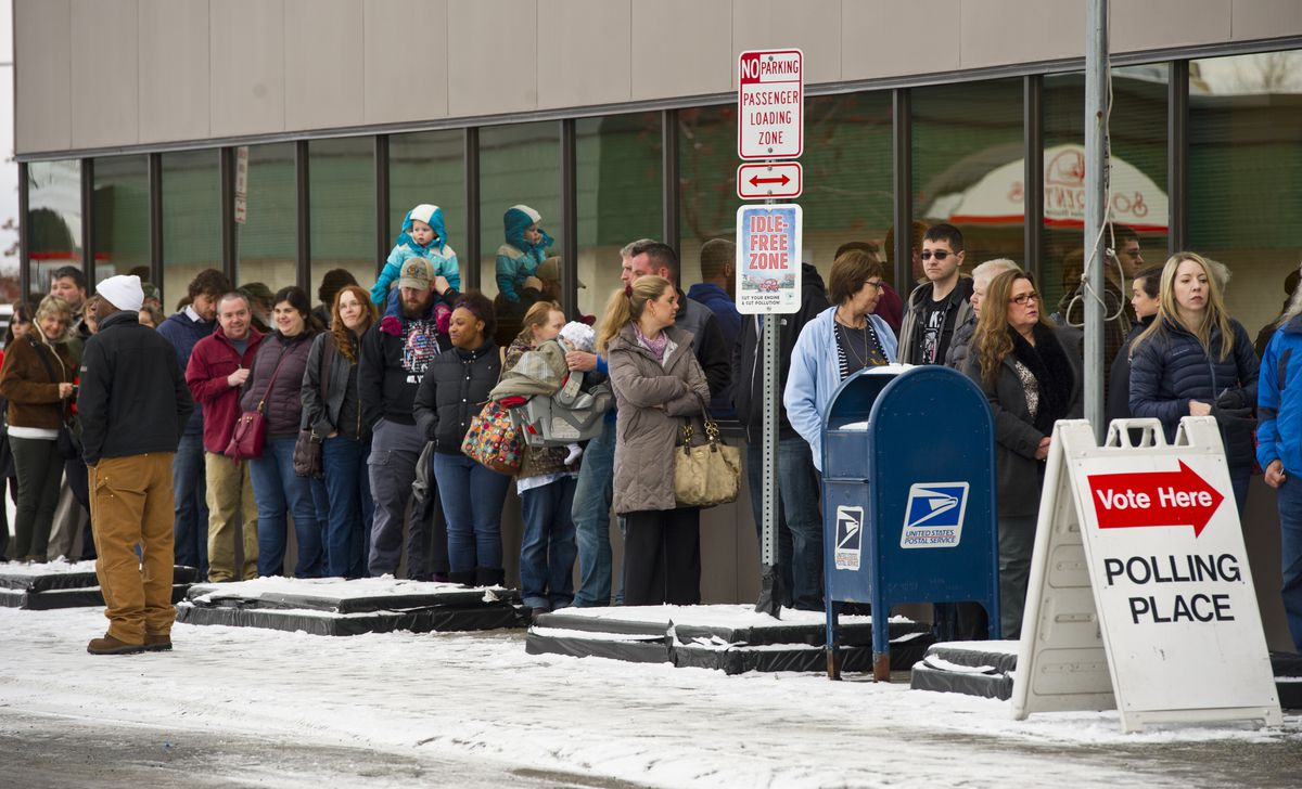 Voters waited in a line outside the Alaska Division of Elections office on Monday, Nov. 7, 2016. (Marc Lester / ADN archive)