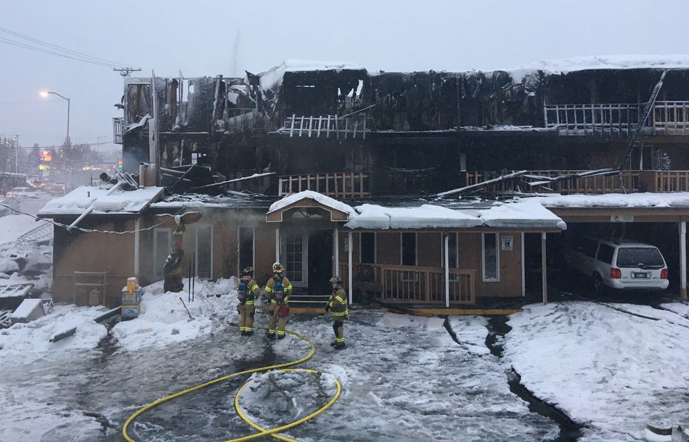 Officials said two people died, 16 were injured and dozens were displaced in an early morning apartment fire at 3811 Minnesota Drive in Anchorageon Wednesday. (Chris Klint / Alaska Dispatch News)