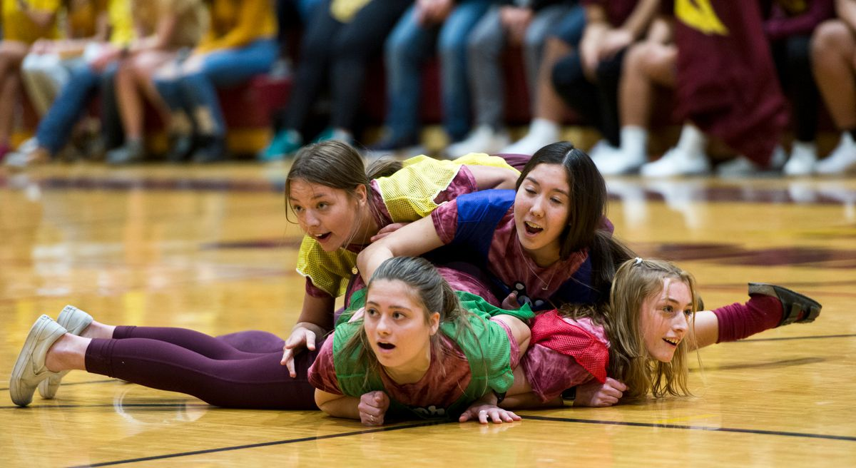 From top, Hailey Hand, Lauren Madden, Mauri Butzke and Mallory Thoma compete in the Dog Pile. (Marc Lester / Anchorage Daily News)