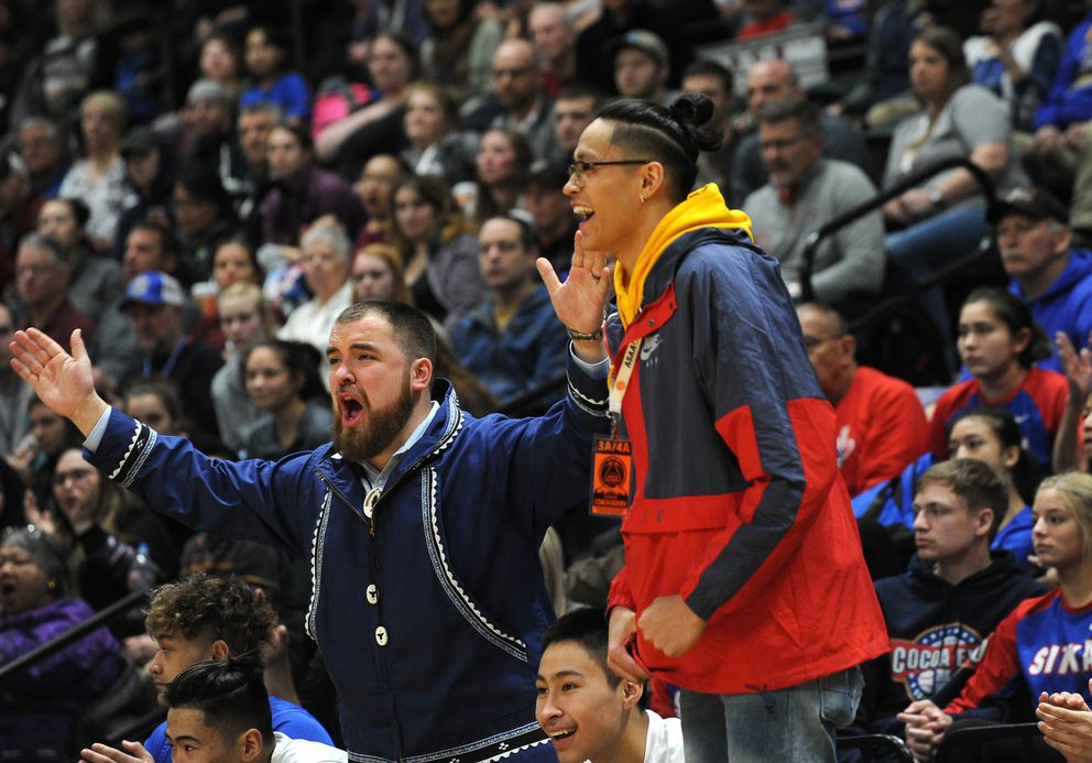 Kamaka Hepa (right) didn't play for the Barrow Whalers last season because he played for a high school in Oregon, but he sat on the Whalers bench to watch his former teammates win the Class 3A state title in March.  (Bob Hallinen / ADN)