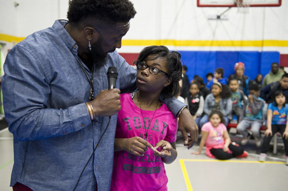 Travis Love answers a question from Kynnedi Grady, 11, at the Mountain View Boys & Girls Club. (Marc Lester / ADN)