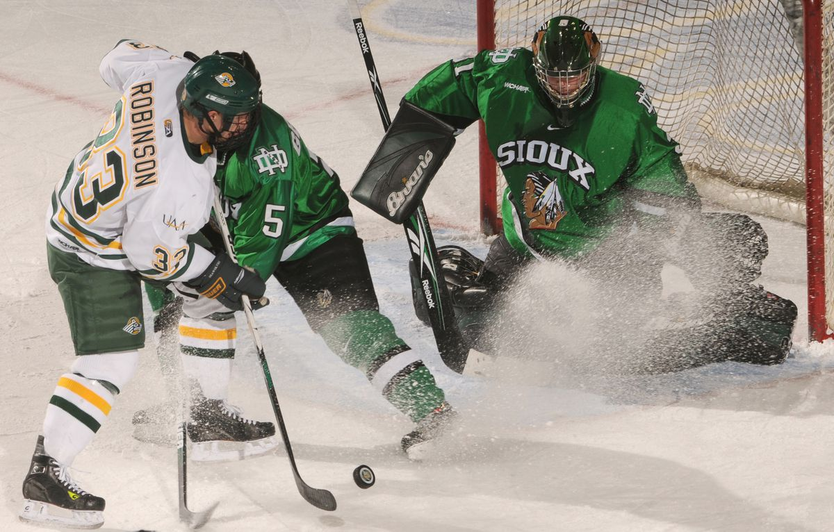 UAA's Mat Robinson, left, can't get the puck past North Dakota's Chay Genoway, center, and goalie Brad Eidsness at Sullivan Arena in Anchorage. (ERIK HILL / ADN archive 2009)