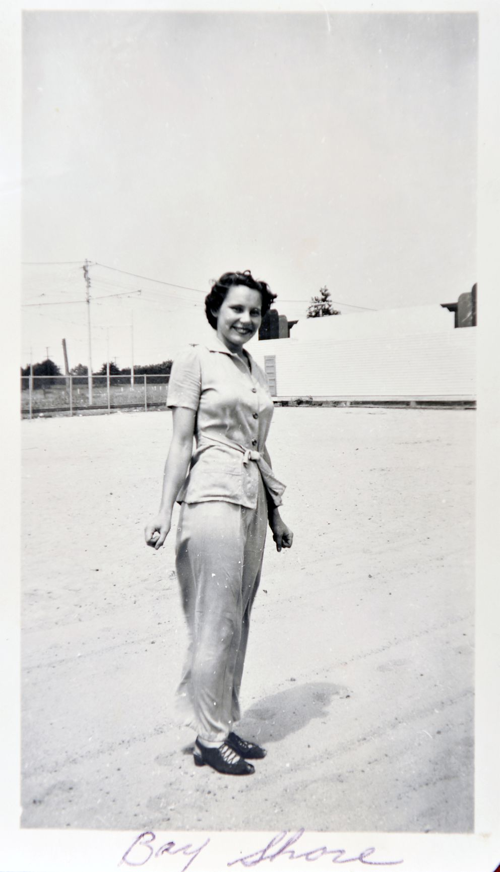 "Gladys Ament poses wearing one of her first pairs of pants. She sent this photo to her husband, Robert ""Bob"" Ament, while he was serving overseas in World War II. (Photo for The Washington Post by Doug Kapustin)"