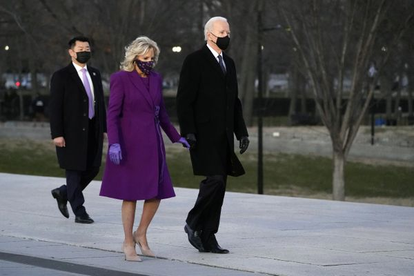 President-elect Joe Biden and his wife Jill arrive for a COVID-19 memorial, with lights placed around the Lincoln Memorial Reflecting Pool, Tuesday, Jan. 19, 2021, in Washington. (AP Photo/Alex Brandon)