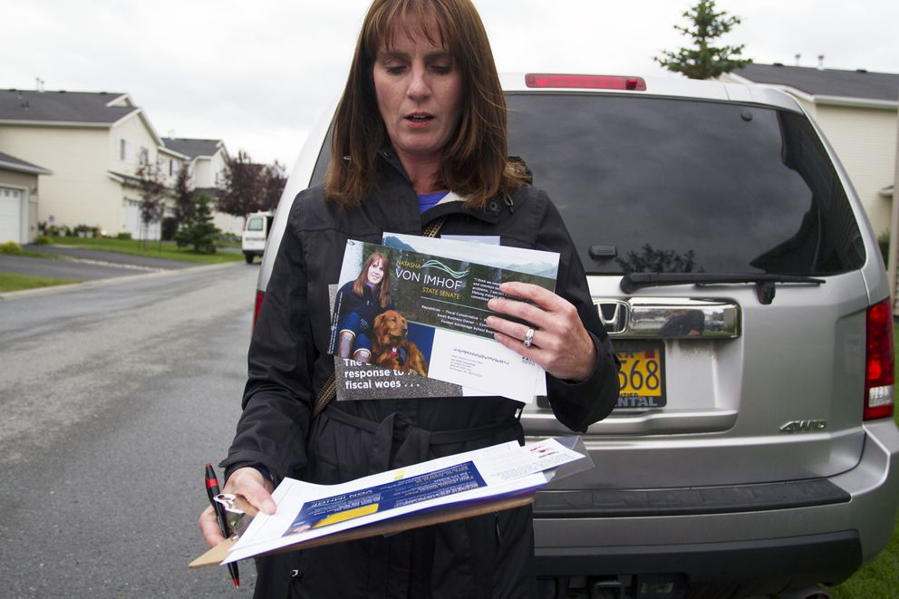 Natasha von Imhof organizes her spreadsheets and fliers before campaigning door-to-door in South Anchorage on Tuesday, July 26, 2016. Imhof is running for the Alaska Senate. (Sarah Bell / Alaska Dispatch News)