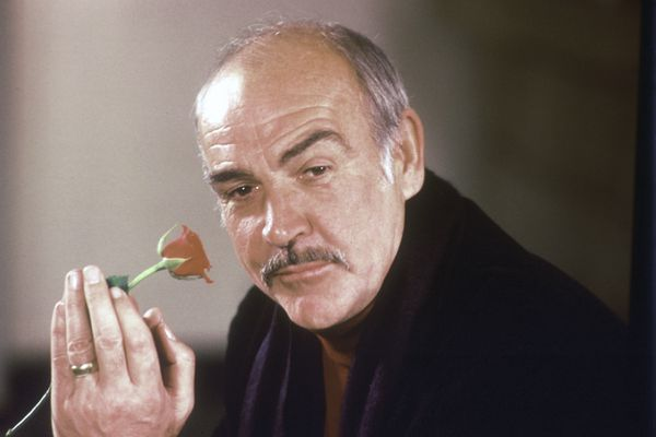 FILE - In this Jan. 23, 1987 file photo, actor Sean Connery holds a rose in his hand as he talks about his new movie