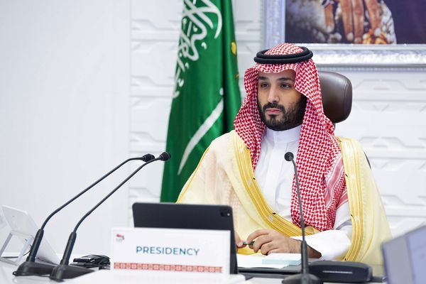 """FILE - In this Sunday, Nov. 22, 2020, file photo, Saudi Arabia's Crown Prince Mohammed bin Salman attends a virtual G-20 summit held over video conferencing, in Riyadh, Saudi Arabia. Saudi Arabia's royal court says Crown Prince Mohammed bin Salman underwent a """"successful surgery"""" for appendicitis on Wednesday, Feb. 24, 2021, and left the hospital soon after the operation. The 35-year-old Prince Mohammed had laparoscopic surgery at the King Faisal Specialist Hospital in the Saudi capital of Riyadh in the morning. (Bandar Aljaloud/Saudi Royal Palace via AP, File)"""