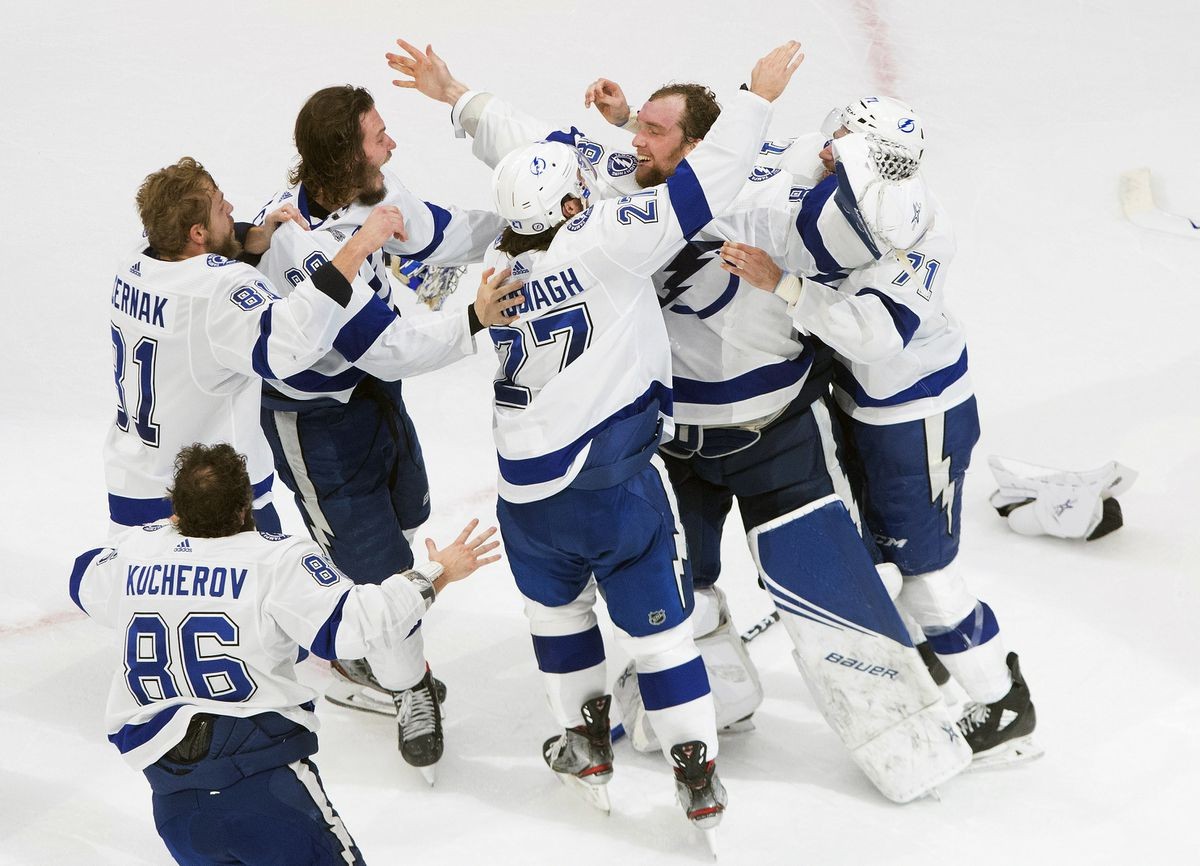 Tampa Bay Lightning players celebrate after defeating the Dallas Stars to win the Stanley Cup in Edmonton, Alberta, on Monday, Sept. 28, 2020. (Jason Franson/The Canadian Press via AP)