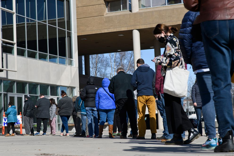 People wait in line outside the Loussac Library's in-person voting location on Tuesday, April 6, 2021. (Marc Lester / ADN)