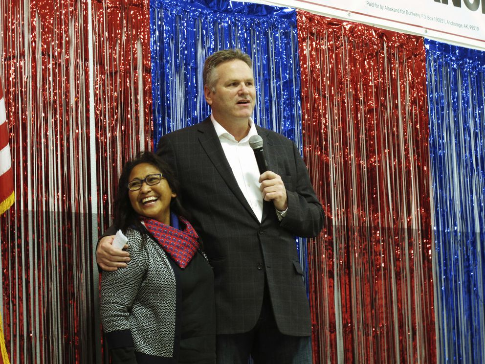FILE - In this Nov. 4, 2018 file photo, Alaska Republican gubernatorial candidate Mike Dunleavy stands with his wife, Rose, on stage during a GOP rally in Anchorage, Alaska. For the first time ever, a U.S. governor will be sworn into office above the Arctic Circle. Dunleavy will become Alaska's top elected official Dec. 3, when he takes the oath of office in Noorvik, a tiny Inupiat Eskimo village above the Arctic Circle and more than a thousand miles from the state capital of Juneau. (AP Photo/Becky Bohrer, File)