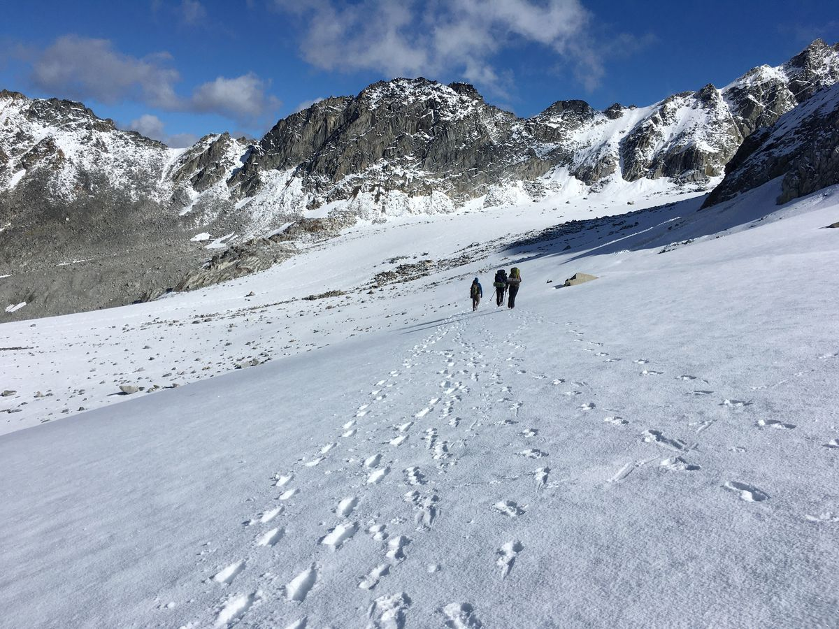 Walking across Bomber Glacier toward its namesake, the crashed plane (not pictured) with eerily well-preserved and massive fragments — bent propellers, parachutes, massive wheels — littering the snowy landscape. (Photo by Alli Harvey)