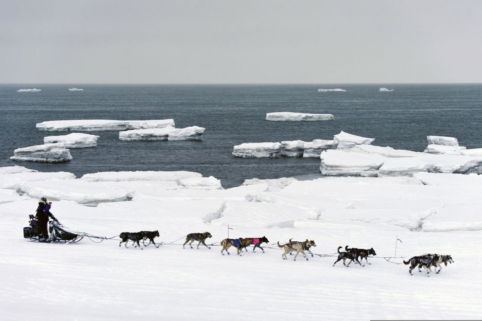 In this March 13, 2019, file photo, Jessie Royer passes icebergs in open water on Norton Sound as she approaches Nome, Alaska, in the Iditarod trail sled dog race. (Marc Lester/Anchorage Daily News)