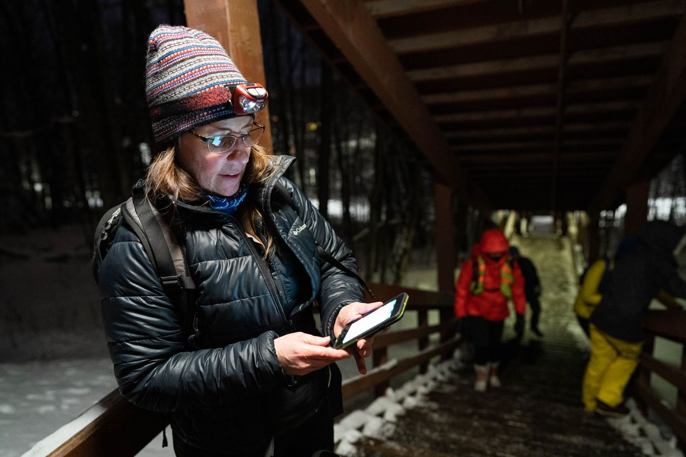 Nancy Burke, Anchorage's housing and homeless services coordinator, enters data into an app during the yearly Point in Time Count on Tuesday night, Jan. 28, 2020 near downtown. The count, required by the U.S. Department of Housing and Urban Development, aims to assist in measuring the extent of homelessness in Anchorage. (Loren Holmes / ADN)