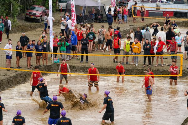 Teams compete at the Big Lake Lions 33rd annual mud volleyball tournament on Saturday, July 25, 2020 in Big Lake. The games drew over 500 people to the day-long event, which was a fundraiser for Big Lake Lions Club. (Loren Holmes / ADN)
