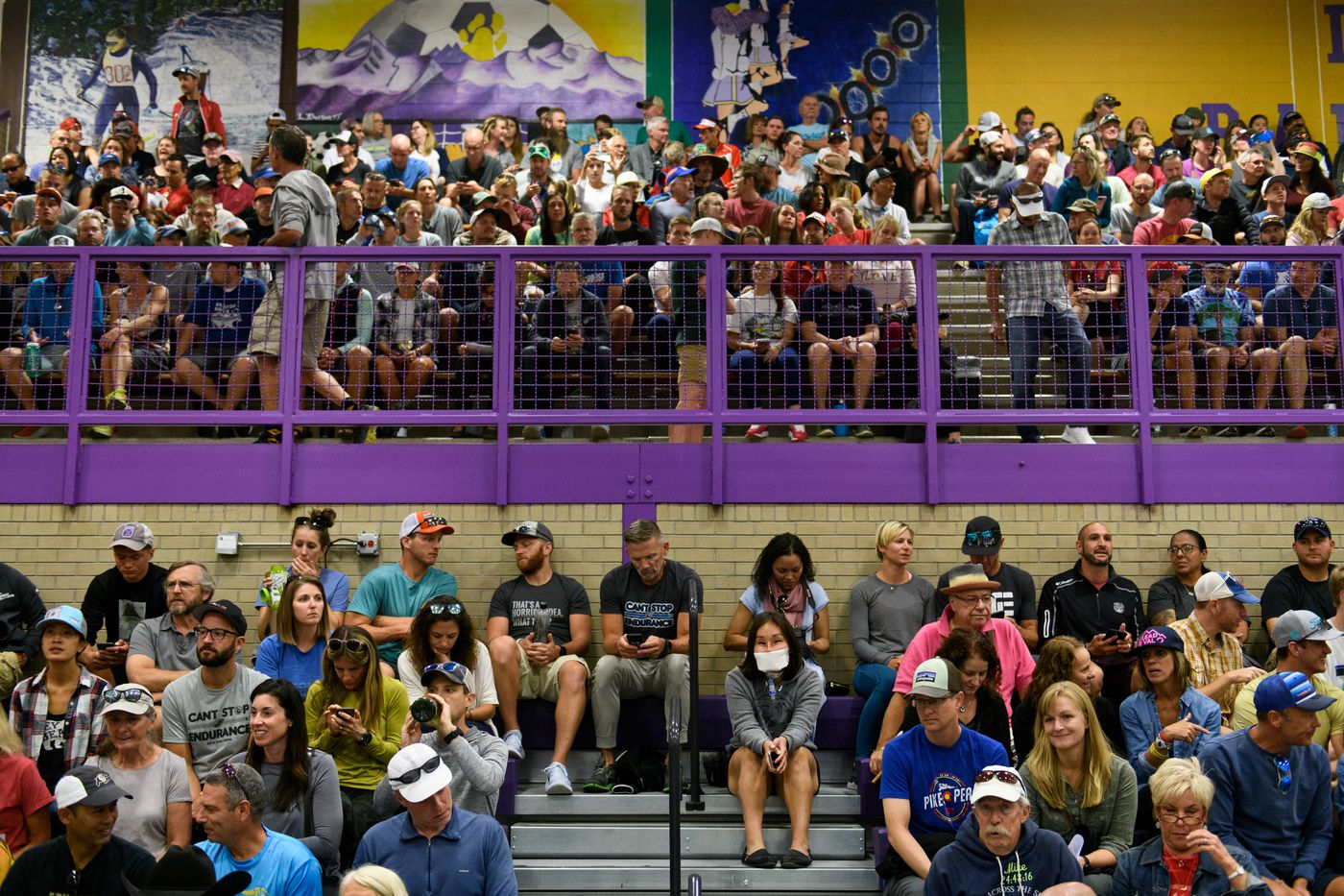Carol Seppilu, near bottom center, listens at a race meeting for Leadville Trail 100 racers and their crew members at a school in Leadville, Colorado. (Marc Lester / ADN)