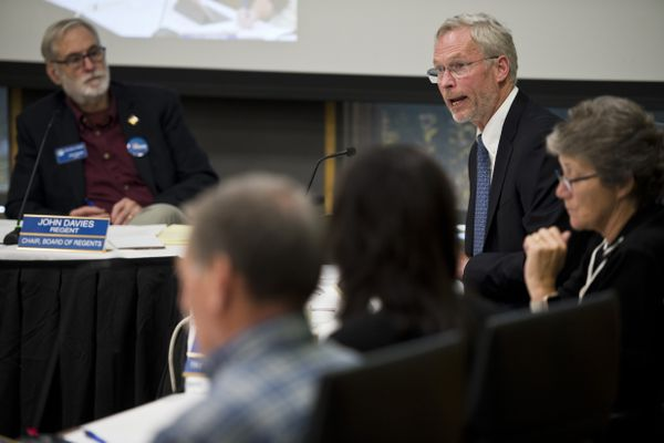 University of Alaska President Jim Johnsen, top right, makes opening remarks. The University of Alaska Board of Regents met at UAA to discuss restructuring the university in the face of budget cuts on July 30, 2019. (Marc Lester / ADN)
