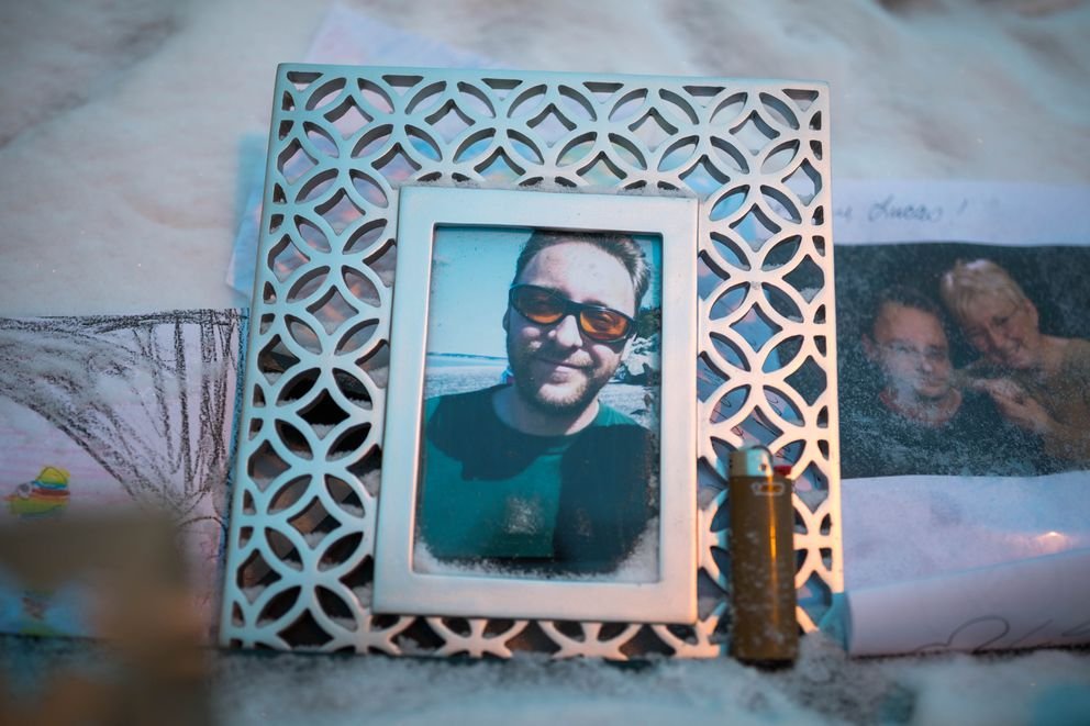 "A memorial for James ""Lucas"" Moren in an alley behind the Gaslight Bar on Tuesday, Dec. 27, 2016. Moren, a patron at the bar, was shot and killed in the alley as the bar was closing early in the morning on Dec. 24. (Loren Holmes / Alaska Dispatch News)"