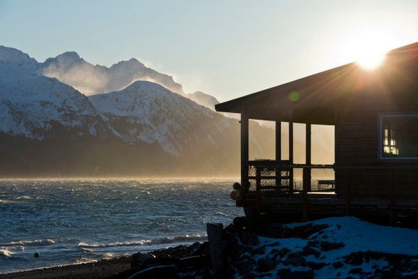 Sunlight hits the ridges surrounding Resurrection Bay and the headquarters of Miller's Landing in Lowell Point on January 24, 2018. (Marc Lester / ADN)