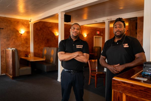 Owner Gregory Daniels left, and cook Kristofer Starks pose for a photo at the Last Call Grill and Delivery on Thursday, July 15, 2021 in Midtown. (Loren Holmes / ADN)