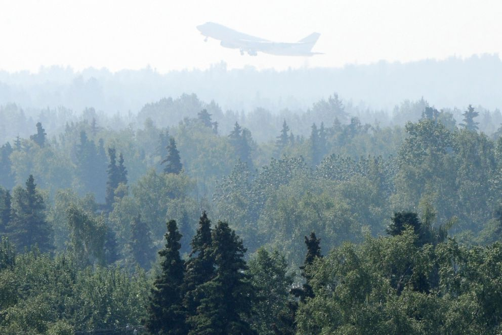 A Boeing 747 takes off from the airport as smoke from the 92,657 acres, or about 144 square mile Swan Lake wildfire on the Kenai Peninsula has settled in Anchorage reducing the visibly and lowering the air quality to an 'unhealthy ' level on Sunday, July 7, 2019. (Bill Roth / ADN)