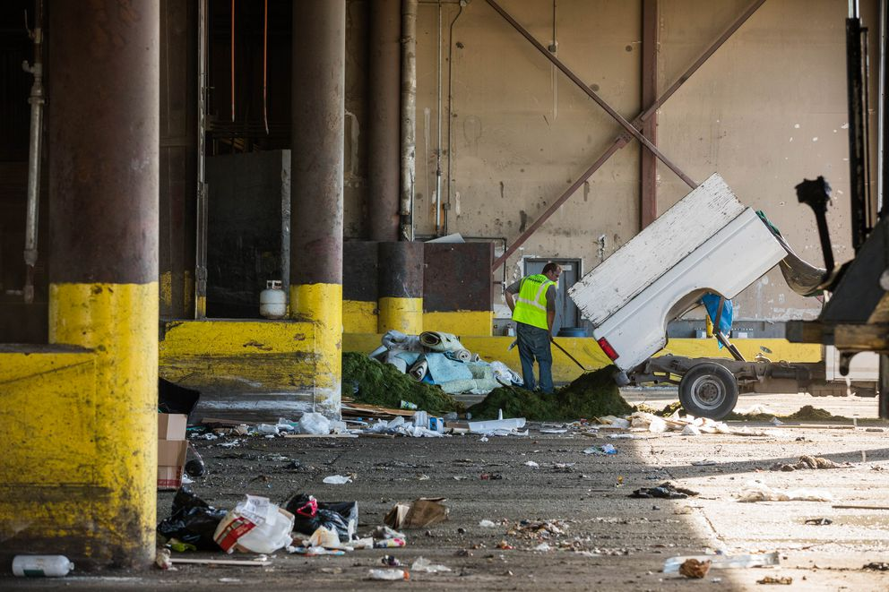 A man unloads trash on the tipping floor at the central transfer station Friday, Aug. 10, 2018. Solid Waste Services, which operates the transfer station, is closing for three weeks starting Aug. 14 for renovations including replacing the tipping floor. (Loren Holmes / ADN)