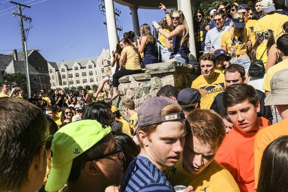 Students at a pregame party before a college football game between the University of Michigan and Pennsylvania State University in Ann Arbor, Mich., Sept. 24. (Sean Proctor / The New York Times)