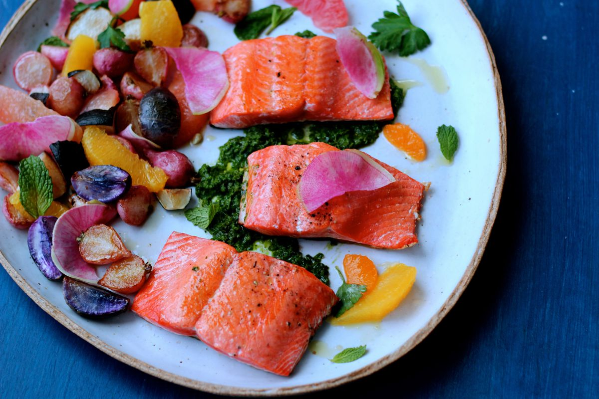 Pan-seared salmon with citrus, brown butter radishes and green herb sauce (Photo by Maya Wilson)