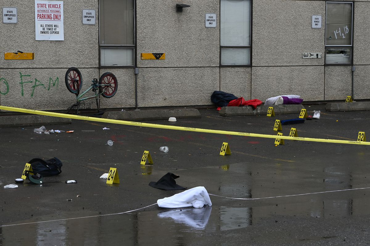 Police investigate the scene of an early morning fatal shooting along Gambell Street between Fourth Avenue and Fifth Avenue near downtown Anchorage on Saturday, June 19, 2021. (Bill Roth / ADN)