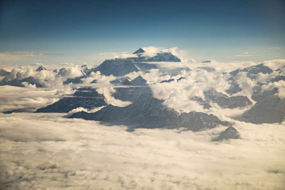 Mount Everest peeks above the clouds on a sightseeing flight, in Kathmandu, Nepal, May 16, 2017. (Josh Haner/The New York Times)