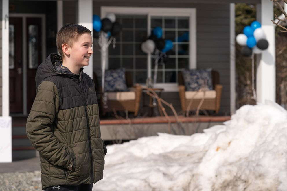 Kaleb Worland, 13, celebrates his birthday with the help of ambulances and fire engines from the Chugiak Volunteer Fire and Rescue Company. (Loren Holmes / ADN)
