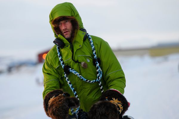 Nicolas Petit arrives in Unalakleet on Sunday morning in the lead of the Iditarod Trail Sled Dog Race on March 10, 2019. (Marc Lester / ADN)