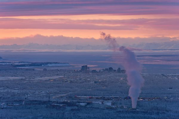 The sunset creates a colorful view of Anchorage in this perspective from Arctic Valley Road on January 14, 2020. (Marc Lester / ADN)