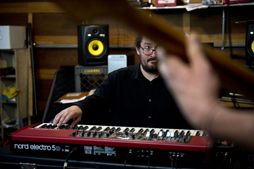 Keyboard player Alex Cruver plays during rehearsal with Life Ain't Fairview Trio on July 10, 2018. (Marc Lester / ADN)
