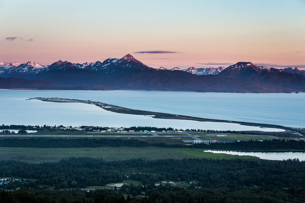 Homer Police have charged a man for the burglary of a cannabis club operated by the Kachemak Cannabis Coalition. Pictured: The town of Homer in the foreground and the Homer Spit jutting out into Kachemak Bay.