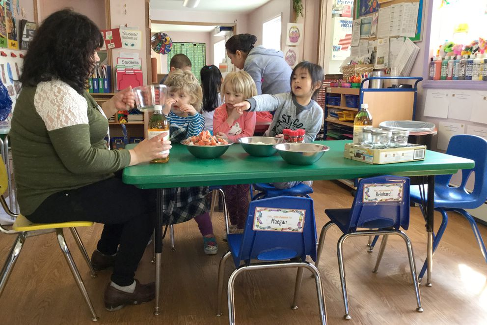 Head Start teacher Marie Schliebe prepares a recipe with salmon in an Unalaska classrom during the pilot program for the new Head Start Traditional Foods Preschool Curriculum. (Aleutian Pribilof Islands Association)