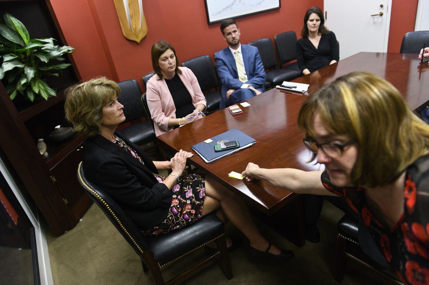 Kristen Daimler-Nothdurft, right, hands Sen. Lisa Murkowski a note during a meeting at her Washington office on June 18, 2019. Daimler-Nothdurft, Murkowski's scheduler, uses the notes to let her know when the next meeting is set to begin in a conference room across the hall. (Marc Lester / ADN)