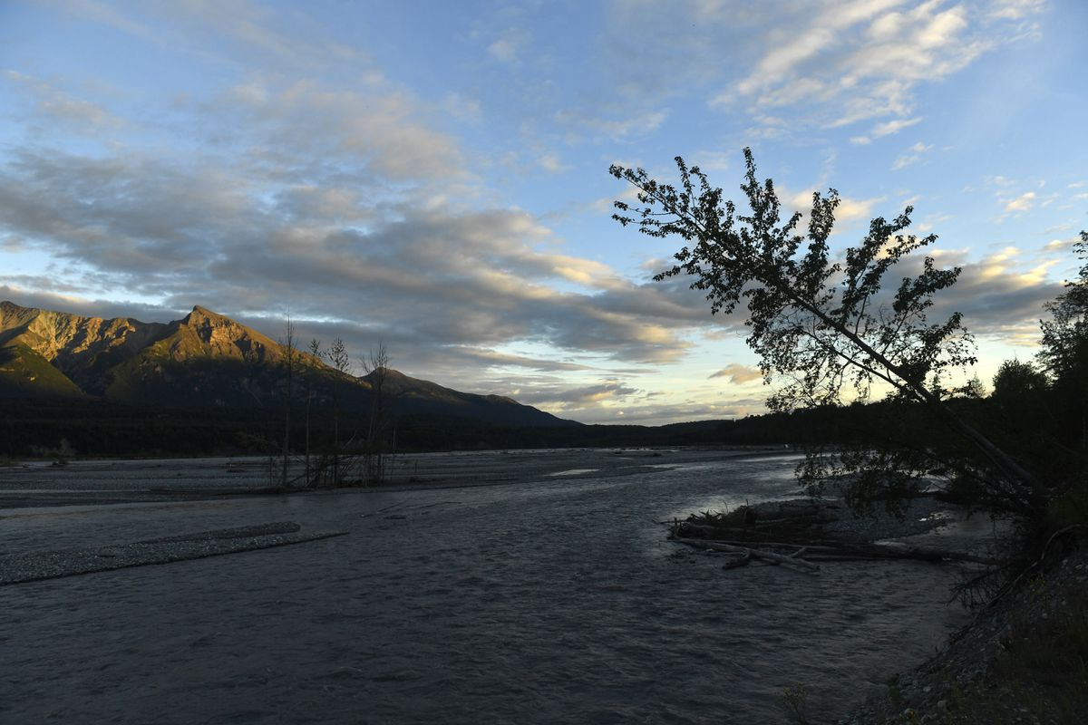 The Matanuska River with the Chugach Mountains lit by the setting sun near Sutton. (Bob Hallinen / ADN file)