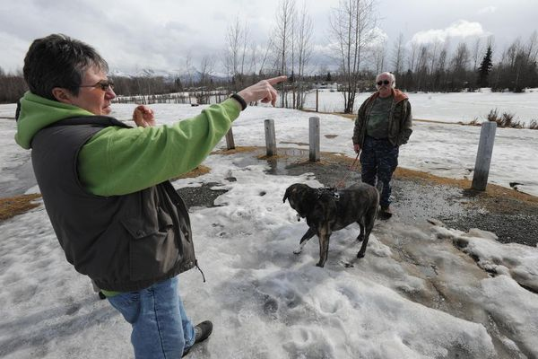 OPINION: A few determined citizens can make a big difference in the life of communities, and Waldron Lake is a prime example. Cherie Northon and Thom Eley walk their dog, Blue, at Waldron Lake. Northon was one of the leaders in the drive to preserve the land around the lake for a park.