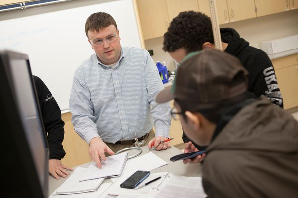 Professor Tyler Spilhaus talks to students about their project during a physics lab in the Natural Sciences Building on the University of Alaska Anchorage campus in Anchorage, Alaska Wednesday, Feb. 17, 2016.