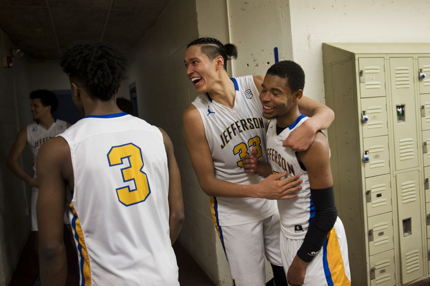 Kamaka Hepa, center, celebrates a win over a rival Portland team on Feb. 16, 2018. Teammate K'lum Strickland is at right and Jalen Brown is at left. (Marc Lester / ADN)
