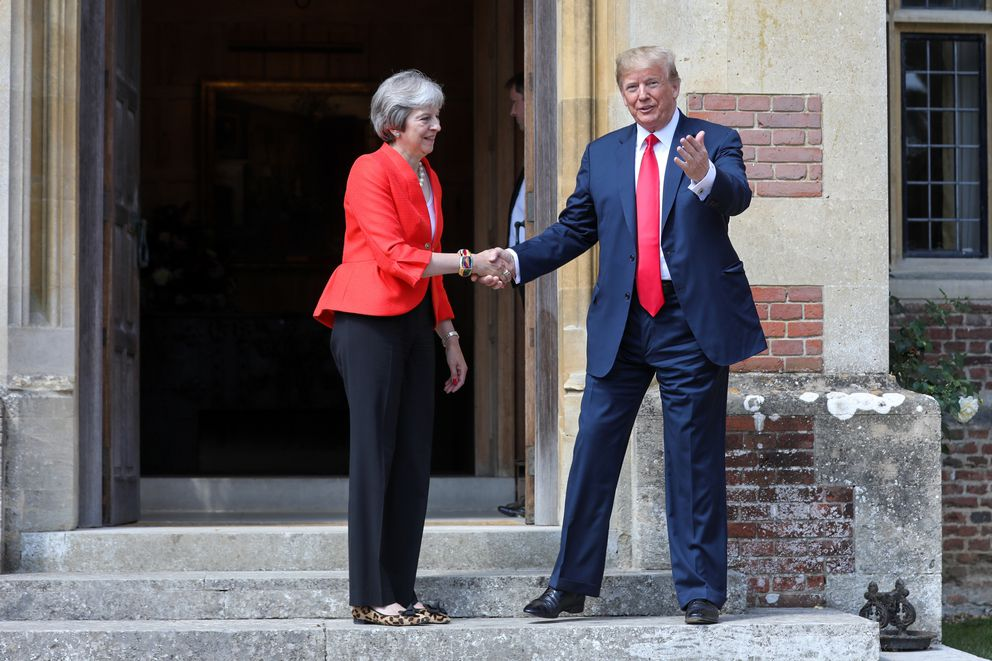 British Prime Minister Theresa May shakes hands with President Donald Trump as he arrives for their bilateral meeting at Chequers on July 13, 2018. (Bloomberg photo by Chris Ratcliffe)