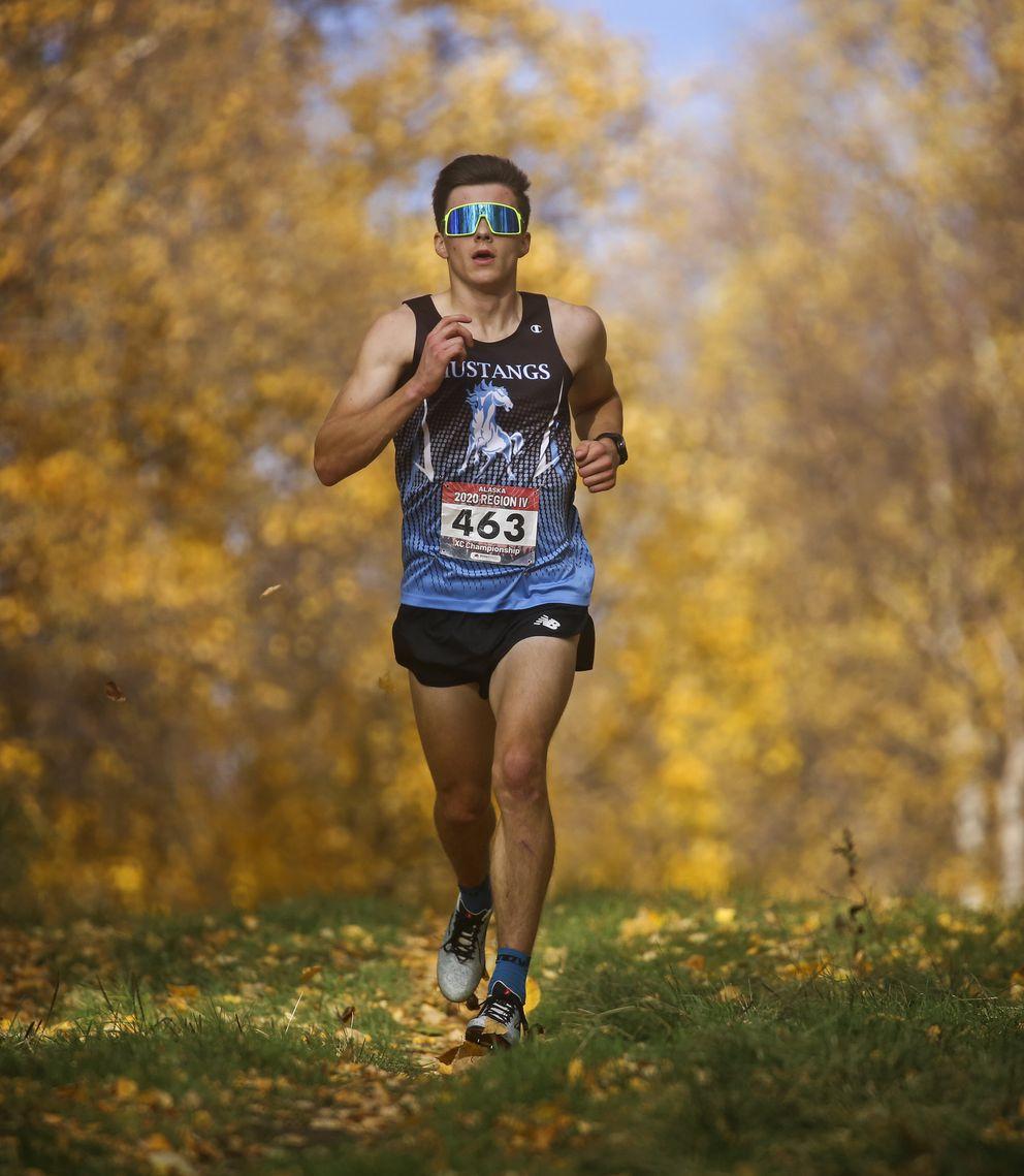 Chugiak's Michael Earnhart runs to a second-place finish. (Emily Mesner / ADN)