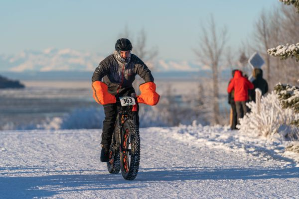Mark Geuss bikes toward the finish line of the Frosty Bottom bike race Saturday, Jan. 11, 2020 at Kincaid Park. Geuss finished the 25-mile course with a time of 2:35:29. (Loren Holmes / ADN)