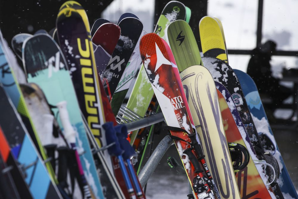 Skis and snowboards outside the tram building at Alyeska Resort in Girdwood on Tuesday, March 23, 2021. (Emily Mesner / ADN)