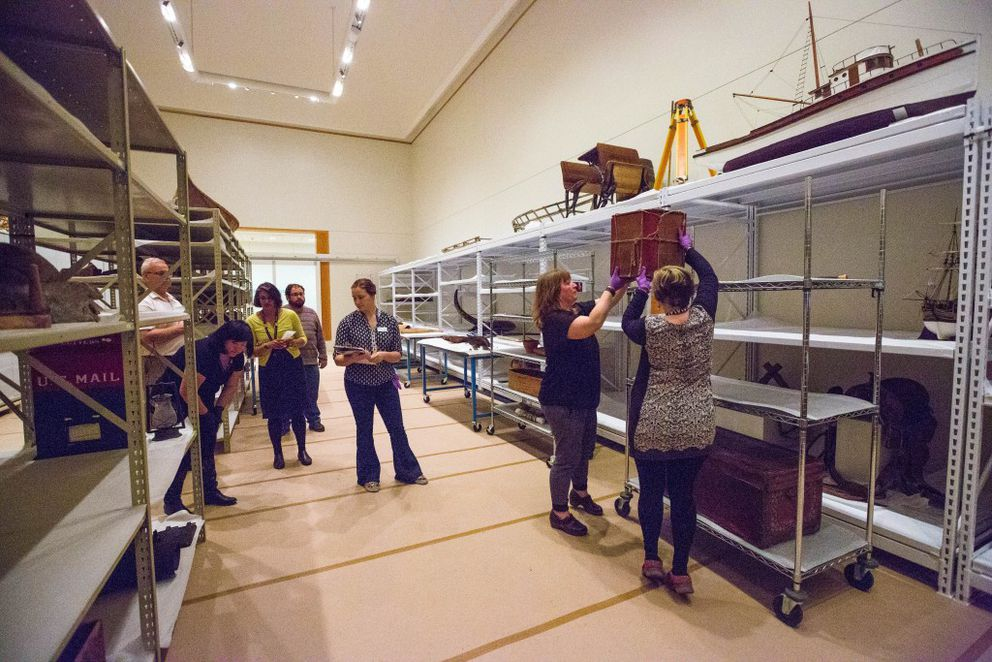 Museum employees carefully store objects from the Alaska Gallery in a temporary space on the first floor of the Anchorage Museum. (Loren Holmes / Alaska Dispatch News)